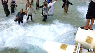 Libyans celebrate opening of Gurdabiya Dam, part of the 'Great Man-Made River' water project, in 2002