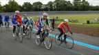Cyclists, led by Chris Boardman, embark upon the inaugural lap of the new track