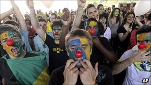 Protesters wearing clown noses whistle and shout during the march against corruption in Brasilia, Brazil, 7 September 2011