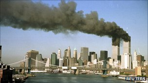 The twin towers of the World Trade Center on fire on 9/11