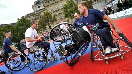 Athletes playing wheelchair basketball