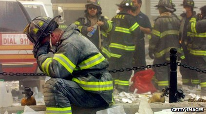 A firefighter breaks down after the World Trade Center buildings collapsed