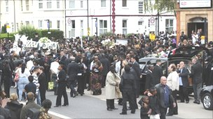 Mourners outside the New Testament Church of God