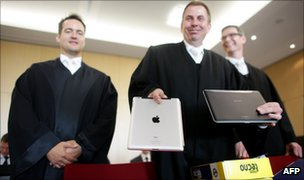 "Samsung""s lawyers showing a Apple iPad computer tablet and a Samsung Galaxy Tab at the Duesseldorf courthouse"