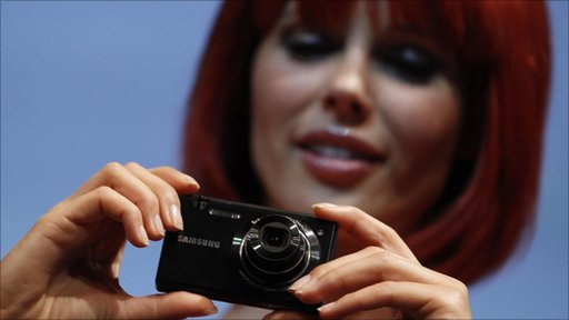 Miss IFA holds a Samsung MV800 digital camera during its presentation during press day at the IFA consumer electronics fair in Berlin