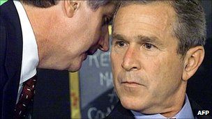 Andy Card whispers into President Bush's ear