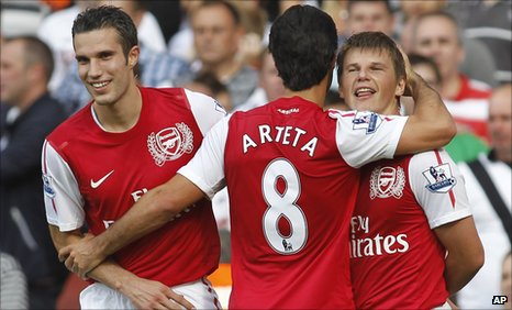 Arteta and Arshavin (right)