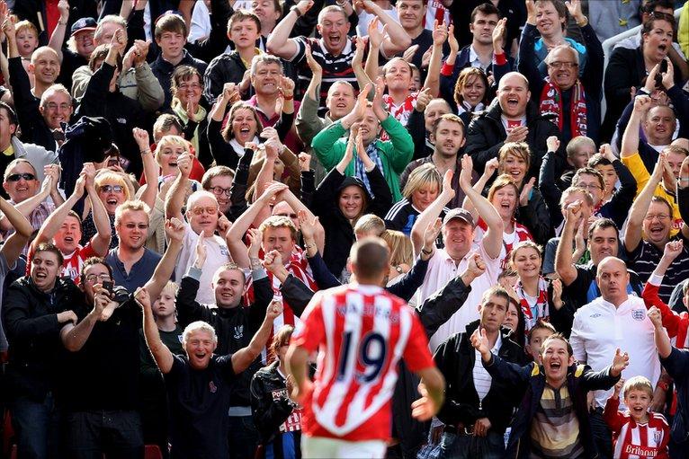 Jon Walters celebrates scoring against Liverpool