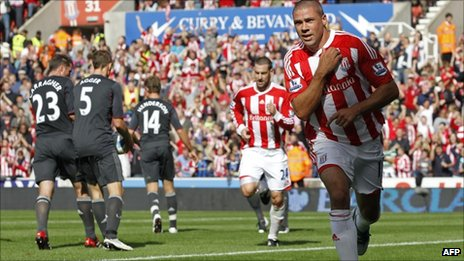 Jonathan Walters celebrates his penalty against Liverpool
