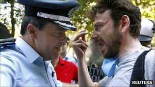 A protester argues with a Greek policeman in Thessaloniki, 10 September