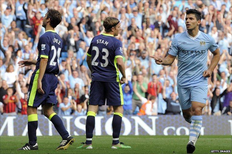 Sergio Aguero (right) celebrates scoring his second goal against Wigan