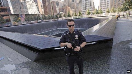 Police officer guards 9/11 Memorial in New York - 9 September 2011