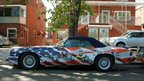 Car painted with the American flag. Photo: Robert Carley