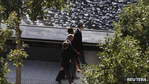 President and Mrs Obama walk with former President Bush and Mrs Bush at Ground Zero