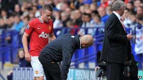 Tom Cleverley (left) was injured at Bolton