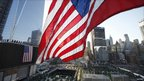 A US flag flies over Ground Zero before the start of ceremonies marking the 10th anniversary of the 9/11 attacks on the World Trade Center, in New York September 11, 2011