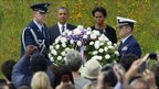 US. President Barack Obama and first lady, Michelle Obama look on as military personal place a wreath in Shanksville, Pennsylvania,