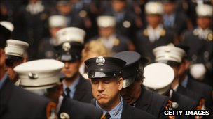 Firefighters attend a memorial service at the Firemen's Monument, New York City