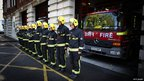 "Members of Clerkenwell Fire Station""s Green Watch observe a minutes silence for their fellow fire-fighters who lost their lives in the 9/11 attacks in New York"