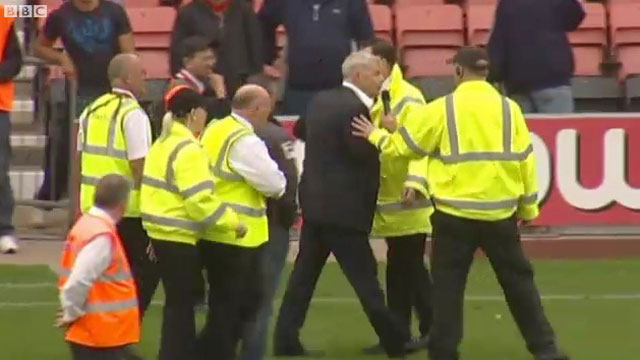 Bournemouth chairman Eddie Mitchell confronts the fans