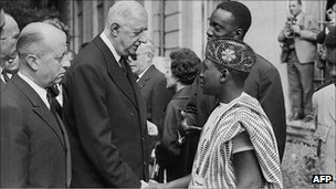 Jacques Foccart (L) and French President General Charles De Gaulle greet African veterans in Paris