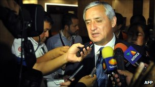 Otto Perez Molina talks to journalists on 12 September