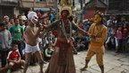 Nepalese Hindu dancers wearing traditional masks perform ahead of Indra Jatra festival in Katmandu, Nepal. The week long festival marks the end of the monsoon season and beginning of autumn.