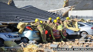 Cars damaged by roof collapse