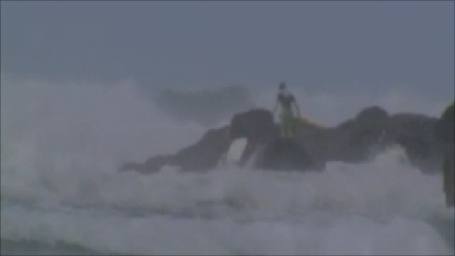 Body boarder on rocks at Porthtowan