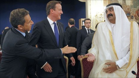 British Prime Minister David Cameron, French President Nicolas Sarkozy and Qatar's Sheikh Hamad bin Khalifa al Thani on 1 Saturday