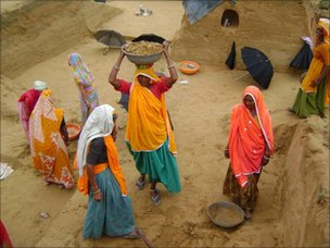 Women digging ditches for water storage