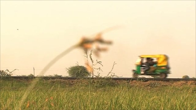 A car driving along a rural Indian road