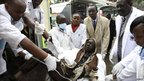 An injured person is assisted by medical personnel upon arrival at Kenyatta National Hospital (12 September 2011)