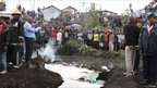 Bodies lay in a river at the scene of a fire at a slum near the industrial area in Nairobi (12 September 2011)
