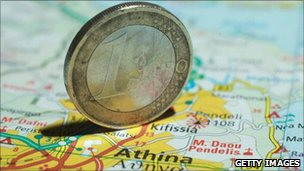 euro coin on a map of Europe