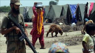 A Pakistani army soldier stands at a flood affected makeshift camp in Khoski Goth in the Badin district, some 140km east of Karachi on August 18, 2011