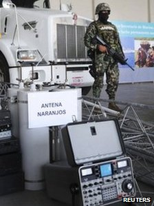 Troops stand next to confiscated communication equipment at a navy base in Veracruz on 8 September 2011.
