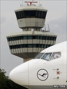 A taxiing Lufthansa aircraft passes the air traffic control tower at Berlin's Tegel airport, 3 August