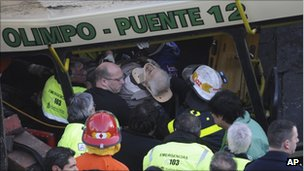 A wounded passenger is carried out the wreckage in Buenos Aires, Argentina