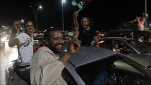Libyans celebrate after Mr Jalil's speech in Tripoli