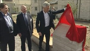Gold medal Olympian Jonathan Edwards unveiling a plaque at the 2012 Olympic village in Dorset