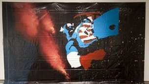 Captain America painted onto a starry background.