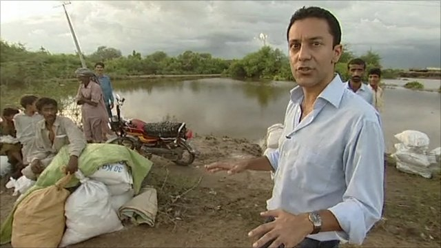 Aleem Maqbool near flooded land in Sindh province