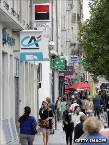 Signs of three French banks on street in Rennes