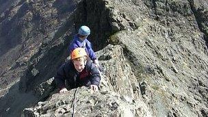 Ben climbing a mountain