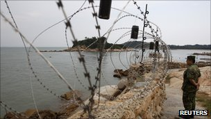 A soldier stands guard in Kinmen, one of Taiwan's offshore islands, on 22 August 2011