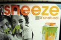 "Orange juice ad doctored to read ""Sneeze it's natural"""
