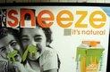 "Orange juice ad doctored to read ""Sneeze it's natural"""
