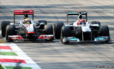Michael Schumancher and Lewis Hamilton battle at Monza.
