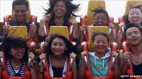 Thrillseekers on a ride at the Happy Valley theme park in Beijing